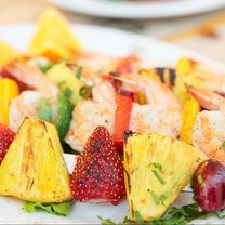 Prawns grilled with fruits - cajun style dish