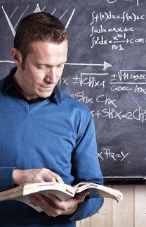 portrait of caucasian teacher and blackboard