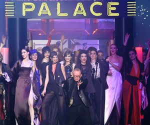 TOPSHOT - French designer Jean-Paul Gaultier (C) acknowledges the audience at the end of his show during the 2016 spring/summer Haute Couture collection on January 27, 2016 in Paris. AFP PHOTO / MIGUEL MEDINA / AFP / MIGUEL MEDINA (Photo credit should read MIGUEL MEDINA/AFP/Getty Images)