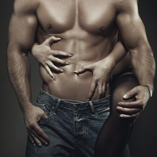 Sexy young couple body at night, woman embrace man abs