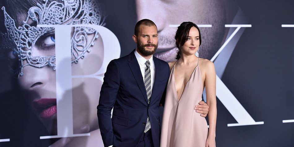 LOS ANGELES, CA - FEBRUARY 02: Actors Jamie Dornan and Dakota Johnson attend the premiere of Universal Pictures' 'Fifty Shades Darker' at The Theatre at Ace Hotel on February 2, 2017 in Los Angeles, California. (Photo by Alberto E. Rodriguez/Getty Images)