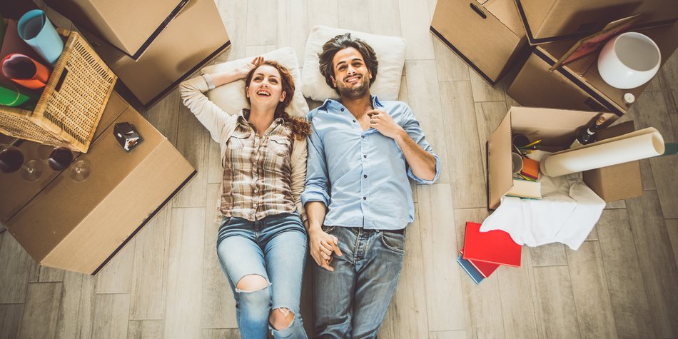 Young couple moving in into new apartment