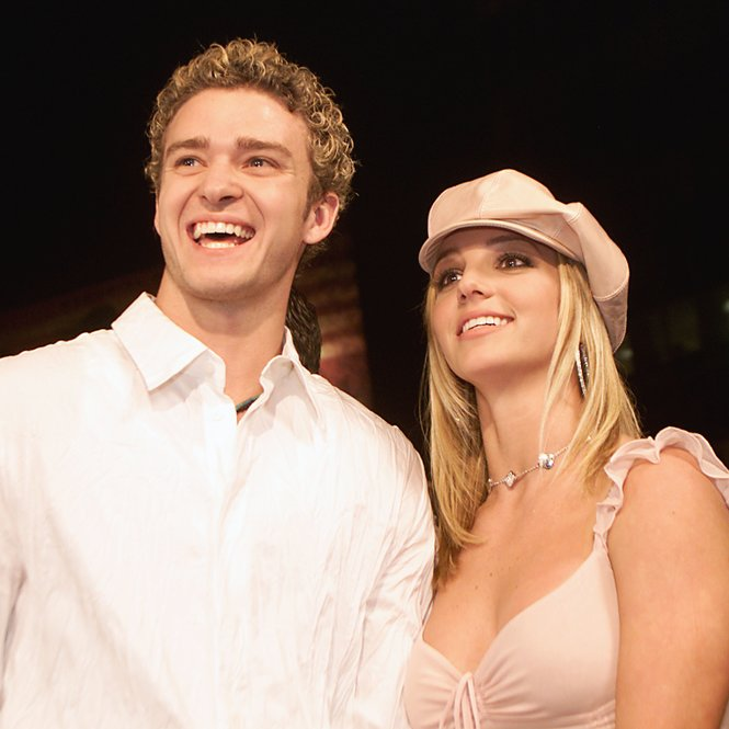"Britney Spears and boyfriend Justin Timberlake arrive at the premiere of her movie ""Crossroads"" at the Mann Chinese Theatre in Hollywood, Ca., Feb. 11, 2002. (photo by Kevin Winter/Getty Images)"