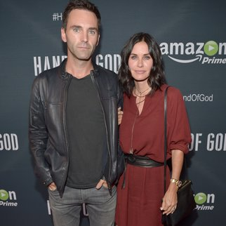 "LOS ANGELES, CA - AUGUST 19: Musician Johnny McDaid (L) and actress Courteney Cox attend the Amazon premiere screening for original drama series ""Hand Of God"" at The Theatre at Ace Hotel on August 19, 2015 in Los Angeles, California. (Photo by Charley Gallay/Getty Images for Amazon Studios)"