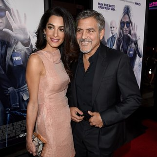 """HOLLYWOOD, CA - OCTOBER 26: Amal Alamuddin (L) and actor George Clooney attend the premiere of Warner Bros. Pictures' """"Our Brand Is Crisis"""" at TCL Chinese Theatre on October 26, 2015 in Hollywood, California. (Photo by Kevin Winter/Getty Images)"""