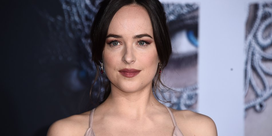 LOS ANGELES, CA - FEBRUARY 02: Actress Dakota Johnson attends the premiere of Universal Pictures' 'Fifty Shades Darker' at The Theatre at Ace Hotel on February 2, 2017 in Los Angeles, California. (Photo by Alberto E. Rodriguez/Getty Images)