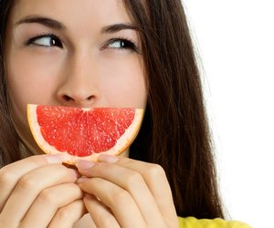 Beautiful young happy woman with fruit