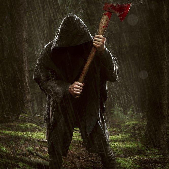 Ax Killer in the rainy wood