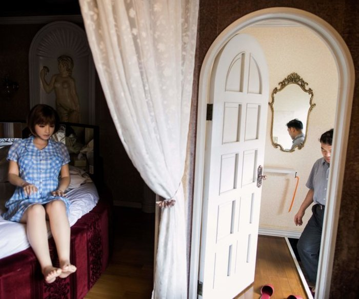 In this picture taken on June 14, 2017, physiotherapist Masayuki Ozaki (R) prepares to check out of a love hotel after spending a night with his silicone sex doll Mayu in Yachimata, Chiba prefecture. Around 2,000 of the life-like dolls -- which cost around 6,000 USD and come with adjustable fingers, removable head and life-like genitals -- are sold each year in Japan, according to industry insiders. / AFP PHOTO / Behrouz MEHRI / TO GO WITH Japan-social-lifestyle,FEATURE by Alastair HIMMER (Photo credit should read BEHROUZ MEHRI/AFP/Getty Images)