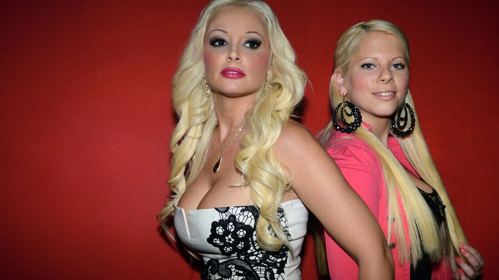 LUDWIGSHAFEN, GERMANY - APRIL 07: Actress Daniela Katzenberger (L) and her half-sister Jennifer Frankhauser (R) pose on April 7, 2014 in Ludwigshafen, Germany. Daniela Katzenberger is in the focus of new regional thriller 'Frauchen und die Deiwelsmilch'. It's her first TV movie role. She plays the bank employee Miri, whose criminal curiosity is challenged as dachshund 'Frauchen' directs her to a corpse. In other roles are seen actors Klaus Zmorek, Carlos Lobo, Stefan Ruppe and J?rgen Ri?mann (Photo by Thomas Lohnes/Getty Images)