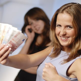 The young attractive women with euro banknote.