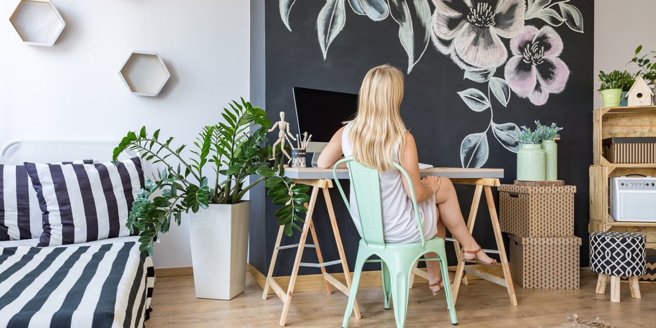 Comfortable and functional home workplace of relaxed woman