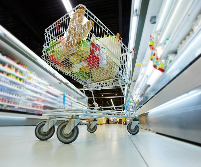 Push-cart with fresh products in hypermarket