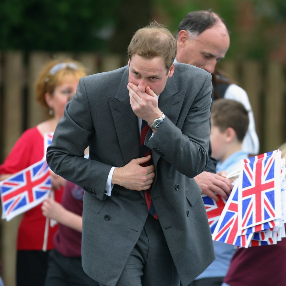 BLACKBURN, UNITED KINGDOM - MAY 09: Prince William stifles a sneeze during a visit to St Aidan's Primary School on May 9, 2008 in Blackburn, England. (Photo by Gary M. Prior/Getty Images)