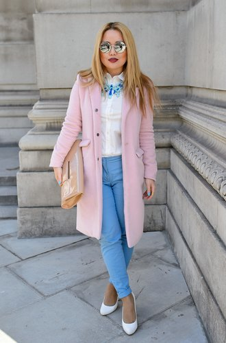 LONDON, ENGLAND - FEBRUARY 16: Student Carly 23 poses wearing a coat by Misguided with Zara trousers and necklace with a Burberry blouse, Faye District bag with Vintage shoes at the Fashion Scout venue at London Fashion Week AW14 at on February 16, 2014 in London, England. (Photo by Ben A. Pruchnie/Getty Images)