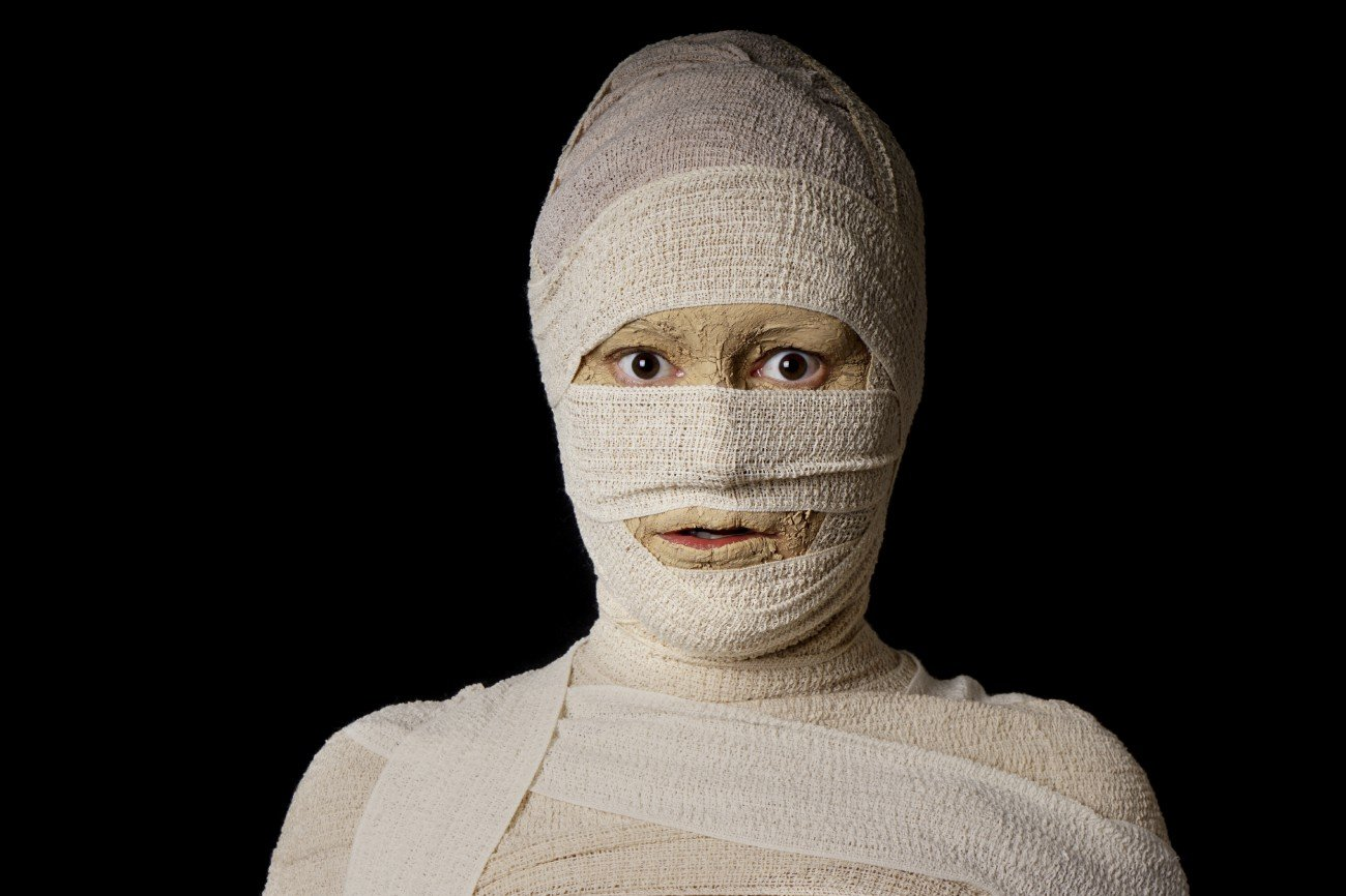 woman wrapped up with bandages as an egyptian mummy for halloween