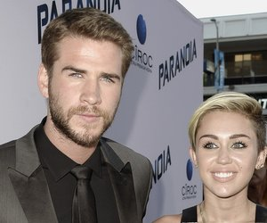 """LOS ANGELES, CA - AUGUST 08: Actress Miley Cyrus (R) and actor Liam Hemsworth (L) attend the premiere of Relativity Media's """"Paranoia"""" at the DGA Theater on August 8, 2013 in Los Angeles, California. (Photo by Kevin Winter/Getty Images)"""