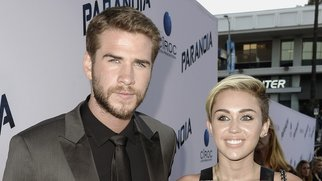 "LOS ANGELES, CA - AUGUST 08: Actress Miley Cyrus (R) and actor Liam Hemsworth (L) attend the premiere of Relativity Media's ""Paranoia"" at the DGA Theater on August 8, 2013 in Los Angeles, California. (Photo by Kevin Winter/Getty Images)"