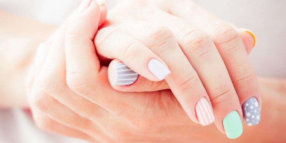 beautiful woman's hand gray background