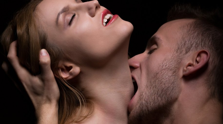 Hot foreplay - passionate man biting woman's neck